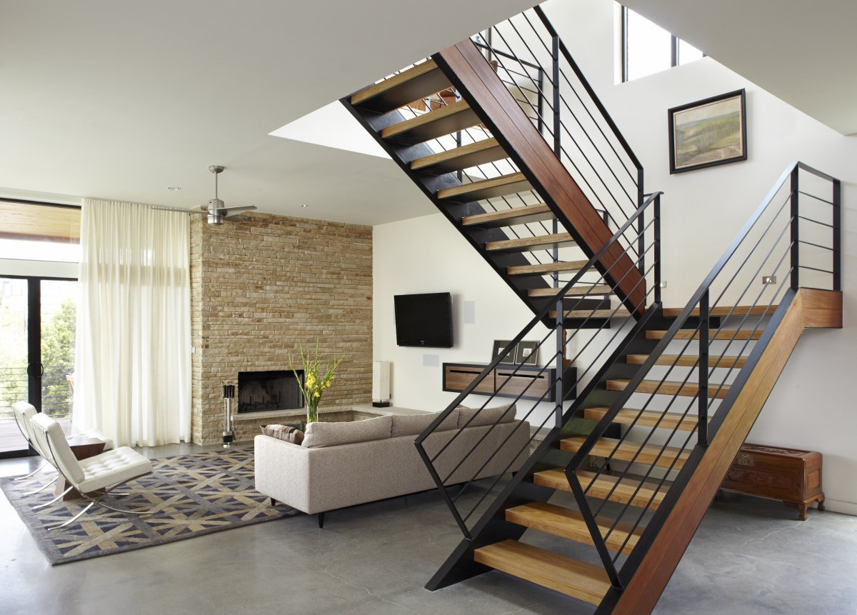 stair-design-ideas-interior-staircase-design-in-main-hall-for-duplex-house-with-sofa-fan-tv-rugs-storage